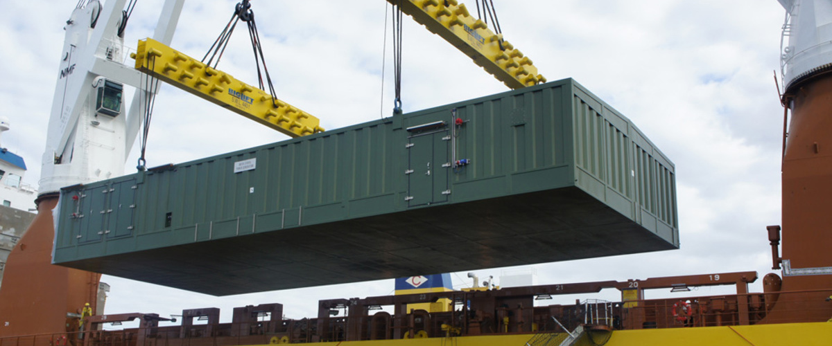 Large module being lowered inot place on ship.