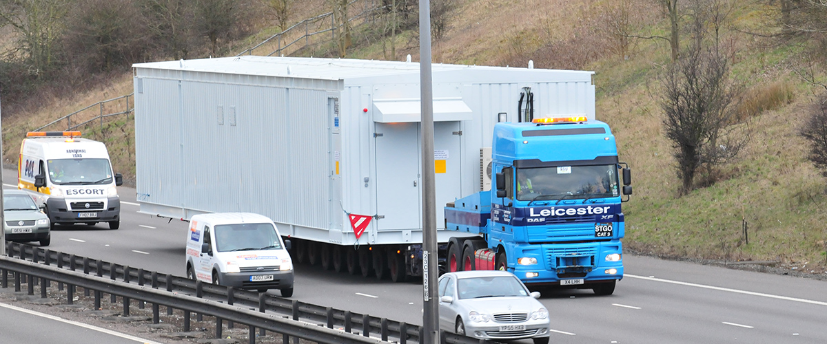 Large single unit, weighing 108 tonnes, being transported.