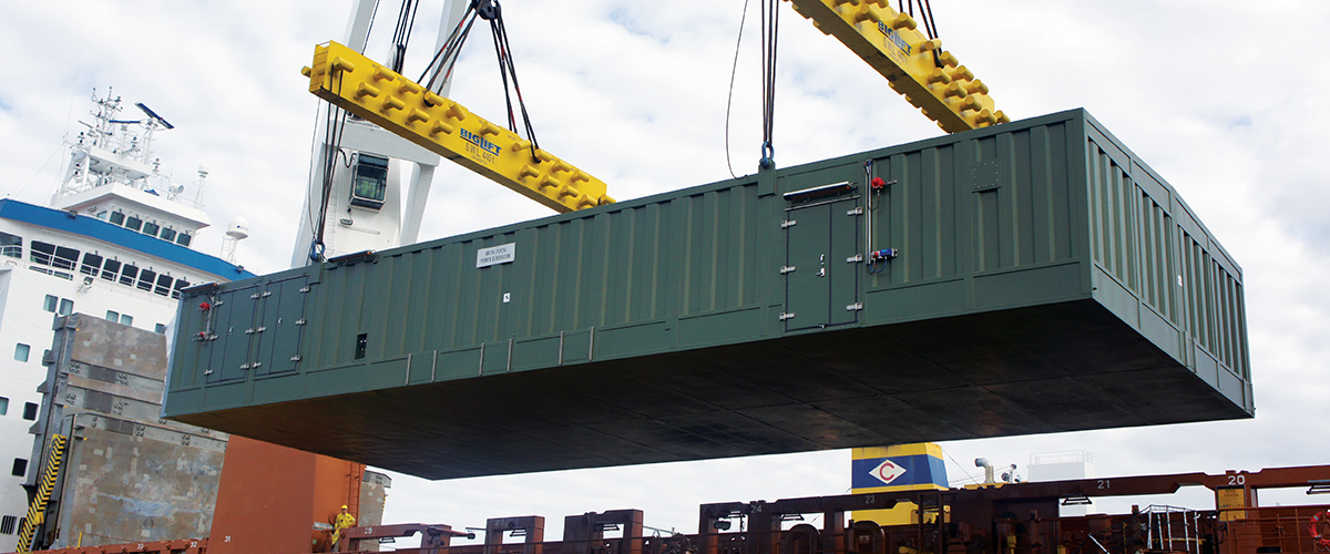 A large onshore container beng lifted into place.