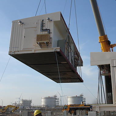 A module being lowered into place onshore.