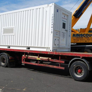 Container in transit, to be used to house UV filtering systems.